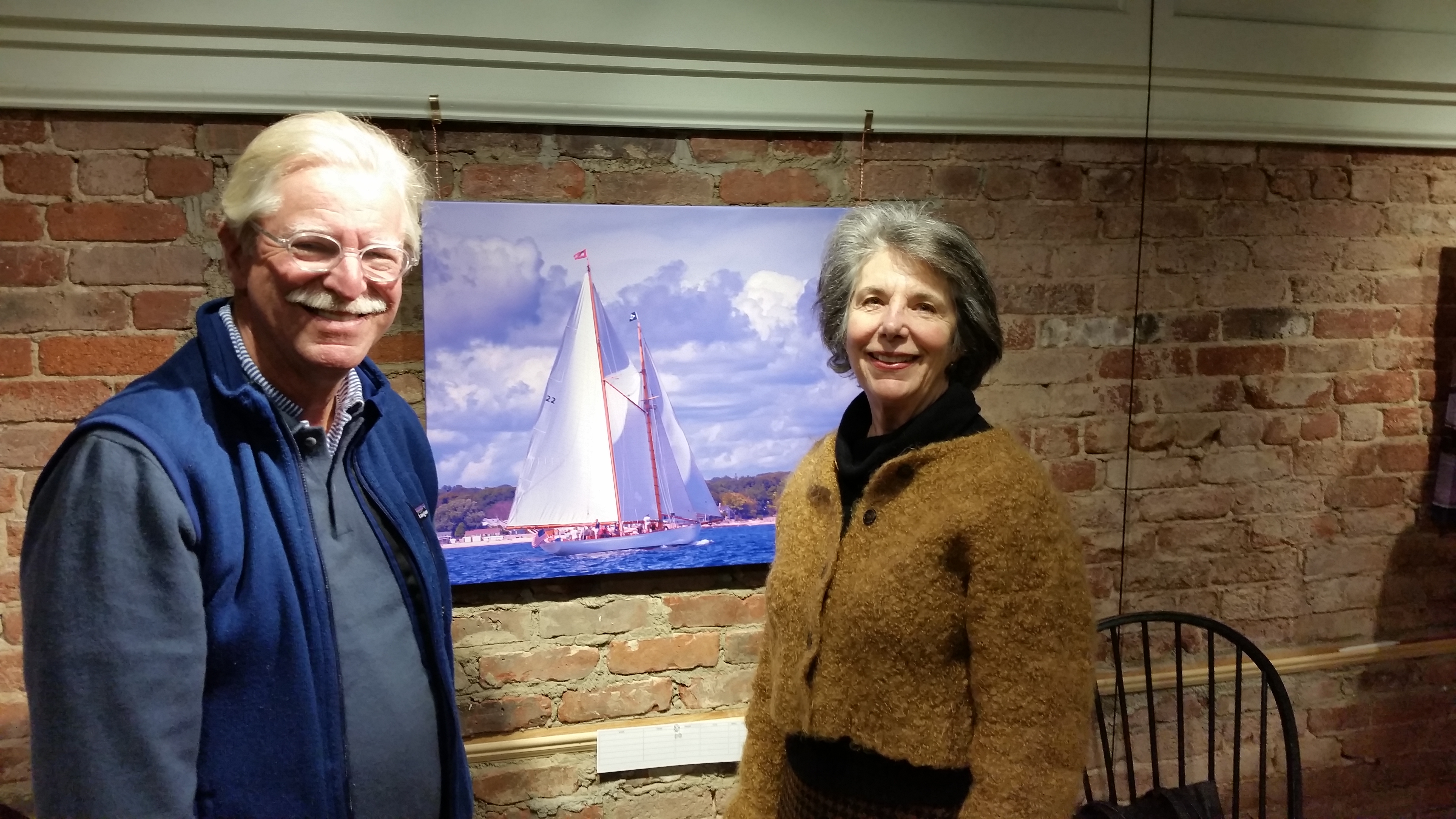 Chris Cox and Penny Parsekian caught admiring one of Joe Geraci's photos of the Brilliant